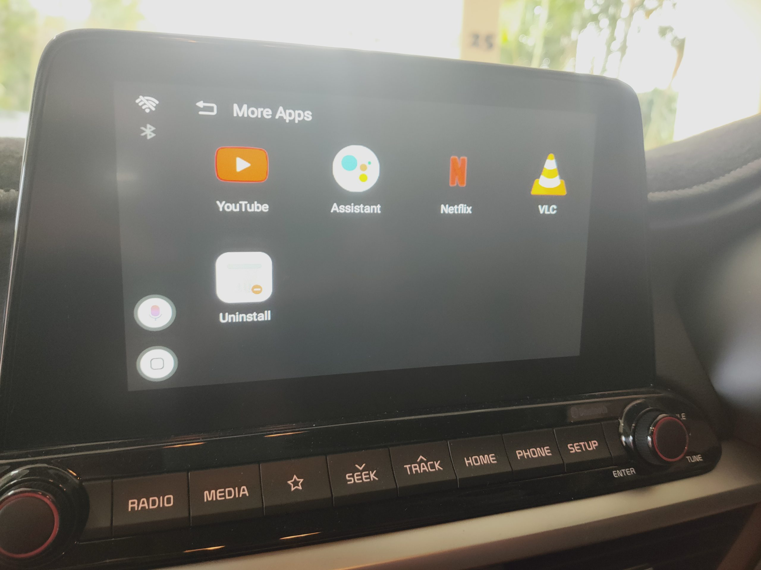 Picture of a Kia radio with a new Android Interface for factory Carplay vehicles. WHatch Youtube and Netflix on your radio screen!
